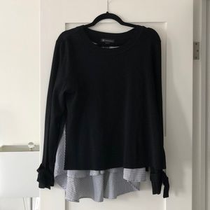 Black top with blue and white underlay. Worn once